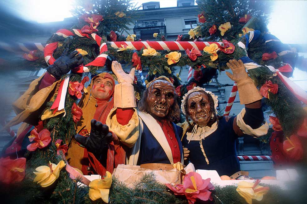 Brother Fritschi, the carnival character of Lucerne, in the procession of 1996 together with his wife © Emanuel Ammon/AURA, Luzern