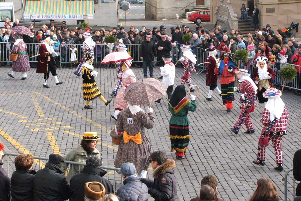 "Carnival characters on the main square in Schwyz in 2011 just before the competition ""Nüsslet"" dancing © Stefan Dettling, Schwyz"