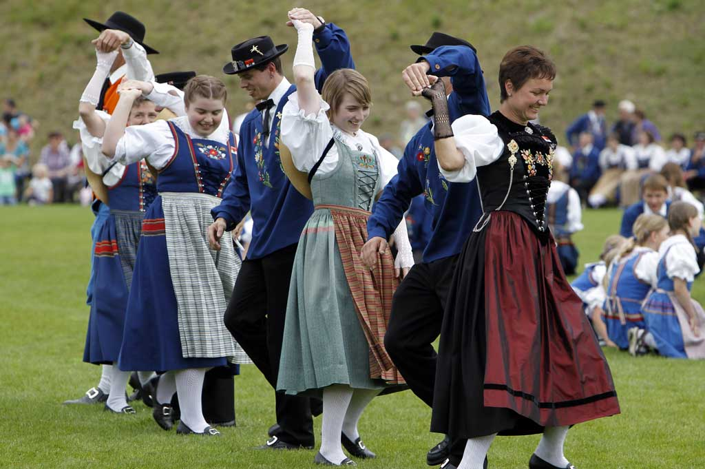 Dancers wearing traditional costumes from the canton of Lucerne take part in the Sachseln Trachtentag (OW), 25 June 2011.