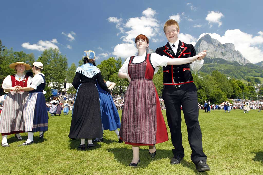 A couple proudly wearing traditional costume: scene from the national Trachtenfest in Schwyz, 5 Juni 2010.